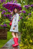 Mujer hermosa con un paraguas Fotografía de archivo libre de regalías