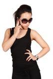 Mujer hermosa de la manera en el teléfono Foto de archivo