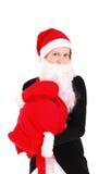 Mujer hermosa de la Navidad en el sombrero de santa. Imagenes de archivo