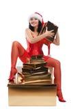Mujer hermosa de la Navidad en el sombrero de santa Fotos de archivo libres de regalías