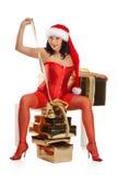 Mujer hermosa de la Navidad en el sombrero de santa Imagen de archivo libre de regalías