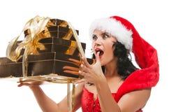 Mujer hermosa de la Navidad en el sombrero de santa Imágenes de archivo libres de regalías