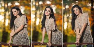 Mujer hermosa en la blusa del cordón que presenta en parque otoñal Mujer morena joven que pasa tiempo en bosque durante temporada Fotos de archivo libres de regalías