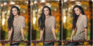 Mujer hermosa en la blusa del cordón que presenta en parque otoñal Mujer morena joven que pasa tiempo en bosque durante temporada Imágenes de archivo libres de regalías