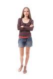 Mujer hermosa en los pantalones cortos, aislados en blanco Imagen de archivo libre de regalías