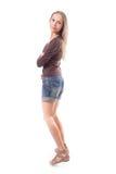Mujer hermosa en los pantalones cortos, aislados en blanco Imagenes de archivo