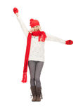 Mujer hermosa en sombrero, silenciador y manoplas Imagen de archivo