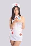 Mujer hermosa en traje de la enfermera Imagenes de archivo