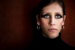 Mujer hermosa en un cuello alto negro Fotografía de archivo