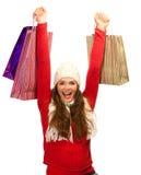 Mujer hermosa feliz de acabar compras de la Navidad foto de archivo