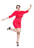 Mujer hermosa feliz del tamaño extra grande en vestido rojo con las manos para arriba Foto de archivo libre de regalías