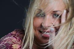 Mujer hermosa ida con el viento Imagen de archivo libre de regalías