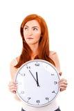 Mujer hermosa joven con el reloj Imagenes de archivo