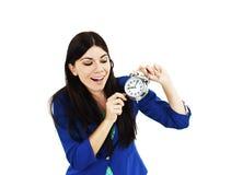 Mujer hermosa joven con el reloj Imagen de archivo