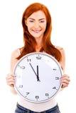Mujer hermosa joven con el reloj aislado en blanco Imágenes de archivo libres de regalías