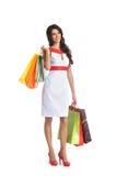 Mujer hermosa joven con los bolsos de compras Imagenes de archivo