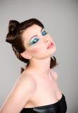 Mujer hermosa joven con maquillaje extremo Imagen de archivo libre de regalías