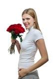 Mujer hermosa joven con un manojo de rosas Fotos de archivo