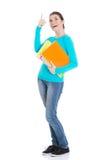 Mujer hermosa joven del estudiante que sostiene el libro de trabajo y que destaca. Imagenes de archivo