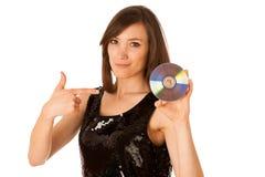 Mujer hermosa joven DJ con Cd en su mano Fotos de archivo libres de regalías