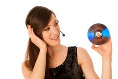 Mujer hermosa joven DJ con Cd en su mano Foto de archivo