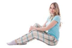 Mujer hermosa joven en la sentada de la ropa de noche aislada en blanco Imágenes de archivo libres de regalías