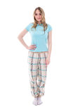 Mujer hermosa joven en los pijamas aislados en blanco Foto de archivo