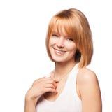 Mujer hermosa joven que sonríe en el fondo blanco Foto de archivo libre de regalías