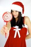 Mujer hermosa Papá Noel con el lollipop Fotos de archivo libres de regalías