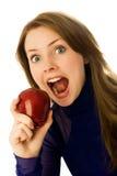 Mujer hermosa que come una manzana Imagen de archivo