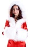 Mujer hermosa que desgasta la ropa de Papá Noel Imagen de archivo libre de regalías