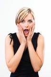 Mujer hermosa que muestra su sorpresa Imagen de archivo libre de regalías