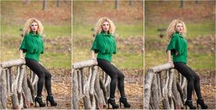 Mujer hermosa que presenta en parque durante la estación del otoño. Muchacha rubia que lleva la presentación verde de la blusa al  Imagen de archivo libre de regalías