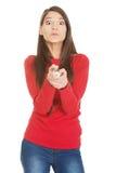 Mujer hermosa que señala en usted con el lápiz grande Imagen de archivo libre de regalías