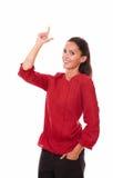 Mujer hermosa que señala encima de sus fingeres Fotografía de archivo