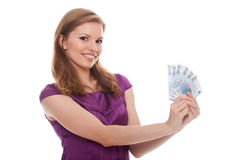 Mujer hermosa que sostiene el dinero euro Foto de archivo libre de regalías