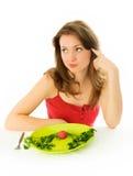 Mujer hermosa triste que guarda una dieta foto de archivo libre de regalías