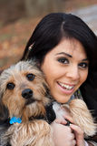 Mujer hispánica con el perro Fotos de archivo