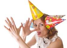Mujer humorística en sombreros del partido Imagen de archivo