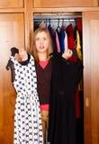 Mujer indecisa con los vestidos Fotografía de archivo libre de regalías
