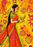 Mujer india con la decoración del diya para la celebración del festival de Diwali en la India