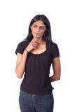 Mujer india que rasguña su barbilla Imagen de archivo libre de regalías
