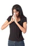 Mujer india que sopla su nariz Fotos de archivo