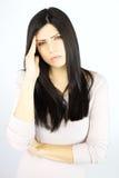 Mujer infeliz con el enfermo del mún dolor de cabeza Fotografía de archivo