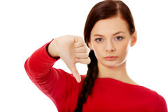 Mujer infeliz joven con el pulgar abajo Imágenes de archivo libres de regalías