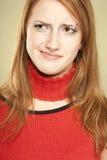 Mujer irónica de la sonrisa Foto de archivo libre de regalías