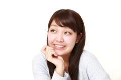 Mujer japonesa joven que sueña en su futuro Fotografía de archivo