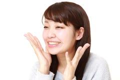 Mujer japonesa joven satisfecha Foto de archivo libre de regalías