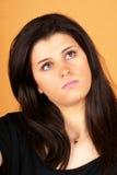 Mujer joven aburrida Foto de archivo libre de regalías