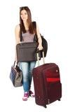 Mujer joven agotada con su equipaje fotos de archivo